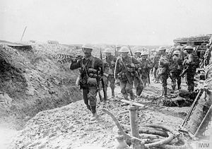 29th Division (United Kingdom) - Wiring party of the 1st Battalion, Lancashire Fusiliers going up to the trenches, Beaumont Hamel, France, July 1916. Note a trench pump in the foreground.