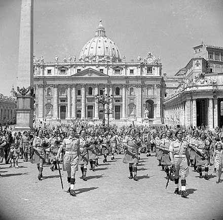 Bands of the British army's 38th Brigade playing in front of St Peter's Basilica, June 1944 The British Army in Italy 1944 NA16179.jpg