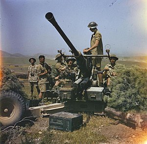 1st Devonshire Artillery Volunteers - A British Bofors gun in action during the drive on Tunis, May 1943