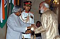 The President, Dr. A.P.J. Abdul Kalam presenting Padma Shri to Shri Sitanshu Yashaschandra, a theorist of culture, at an Investiture Ceremony at Rashtrapati Bhavan in New Delhi on March 29, 2006.jpg