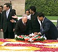 The President of Italy, Mr. Carlo Azeglio Ciampi laying wreath at the Samadhi of Mahatma Gandhi at Rajghat in Delhi on February 14, 2005.jpg