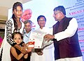 The Union Minister for Communications & Information Technology, Shri Ravi Shankar Prasad presenting the certificates of Sukanya Smrudhi Yojana to the beneficiaries, at a function 'Vikas Parva', in Mumbai.jpg