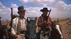 "The Searchers - ""I figure on gettin' myself un-surrounded,"" insists Captain Clayton (Ward Bond) to Ethan (John Wayne) as they realize they are caught in a trap and must run for their lives."