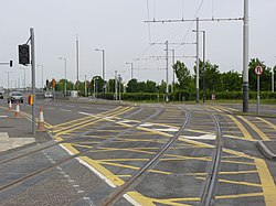 Tramway crossing on South Gyle Broadway (geograph 3505863).jpg