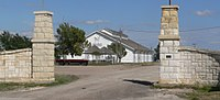Trego County fairgrounds exhibit bldg through gates1.JPG