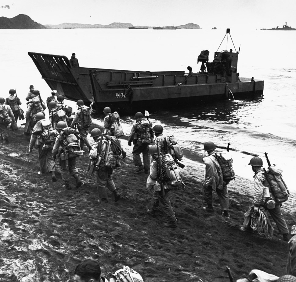 Troops marching up beach during loading for Kiska operation, 13 August 1943 (80-G-475421)