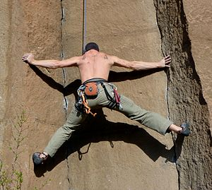 Crack climbing - A top rope climber in the classic stemming position
