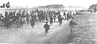 Kumul Rebellion - Turkic Uyghur soldiers who were forcibly conscripted into the 36th Division waving Kuomintang flags near Kumul
