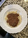 spaghetti topped with chili