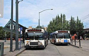 Rose Quarter Transit Center - Buses at the transit center in 2013. The MAX station is in the background, at right.