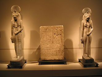 Two statues of goddess Sachmet and grave relief.jpg