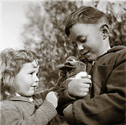 Two young refugees from Luxembourg with their pet rabbit in Surrey (faux vintage).jpg