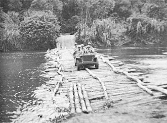 Kapa Kapa Trail - Members of the 2nd Battalion, 126th Infantry Regiment, U.S. 32nd Division, in an Army Bantam Jeep crossing a river on the southern portion of the Kapa Kapa Trail in Papua New Guinea during October 1942.