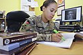 U.S. Army Cpl. Natasha Hunter, a staff judge advocate paralegal with the 4th Infantry Division and Regional Command South, researches regulations at her office at Kandahar Airfield, Afghanistan, Sept 130901-A-RY828-297.jpg