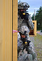 U.S. Army Staff Sgt. Ashley Tyler, crouching, with the 100th Security Forces Squadron, clears a building during mobile urban operations training at Sembach Air Base, Germany, July 1, 2011, before she deployed to 110701-F-EJ686-075.jpg