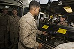 U.S. Marines and Sailors with the 26th MEU and USS Kearsarge share a Christmas meal 151222-M-PA636-116.jpg