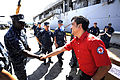 U.S. Navy Cmdr. Antonio Hull, left, commanding officer of amphibious dock landing ship USS Harpers Ferry (LSD 49), shakes hands with Eduardo Buena, administrator for the Olongapo City chapter of the Philippine 101025-N-OX597-006.jpg