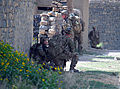U.S. Soldiers with Echo Company, 2nd Battalion, 506th Infantry Regiment, 4th Brigade Combat Team, 101st Airborne Division pull security while Afghan National Army soldiers with the 2nd Battalion, 1st Brigade 130602-A-DQ133-222.jpg