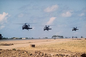Sikorsky UH-60 Black Hawk - UH-60A Black Hawks over Port Salinas during the invasion of Grenada, 1983. The conflict saw the first use of the UH-60 in combat.