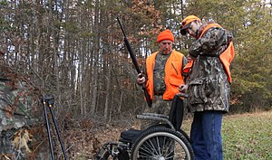 High-visibility clothing - Deer hunters wearing blaze orange for identification as humans, not game animals