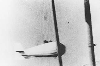 Spy basket - An aeroplane photographed this spy basket in operation hanging from the American USS Macon in 1934-09-27.