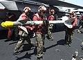 US Navy 020402-N-0012S-006 USS Kennedy - missile unload.jpg