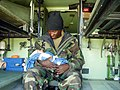 US Navy 030402-M-8664K-001 U.S. Navy Corpsman delivers Iraqi child.jpg
