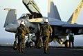 US Navy 030813-N-6213R-188 Naval aviators assigned to the Diamondbacks of Strike Fighter Squadron One Zero Two (VFA-102) walk toward an F-A-18F Super Hornet.jpg
