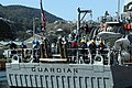 US Navy 040310-N-8937A-036 Sailors assigned to USS Guardian (MCM 5) stand by as the ship is moored at a dry dock in Sasebo, for a one-month maintenance and repair schedule.jpg