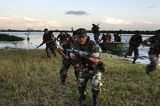 Marines - Peruvian marines conducting amphibious assault exercises on the Amazon River