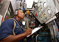 US Navy 040731-N-4374S-009 Fireman Apprentice Marquis Petty monitors the engine gauges in the main machinery room aboard the mine countermeasure ship USS Dextrous (MCM 13).jpg