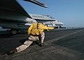 US Navy 040904-N-4565G-005 Lt. Cmdr. Robert Lacy, of Richmond, Va., signals the launch of an F-A-18C Hornet.jpg