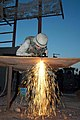 US Navy 041113-N-5386H-050 Steelworker 1st Class Joseph Perrott, assigned to Naval Mobile Construction Battalion Two Three (NMCB 23), cuts steel plating used to enhance tactical vehicle armor.jpg