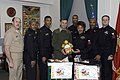 US Navy 041217-N-3955L-001 Chief of Naval Operations Command Master Chief, Master Chief Petty Officer Jimmy Paulk, left, and the Pentagon First Class Petty Officer Association (PFCPOA) give toys to U.S. Marine Corps Vice Comman.jpg