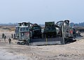 US Navy 050111-N-3557N-007 Marines assigned to 26th Marine Expeditionary Unit (MEU), load equipment on a Landing Craft Air Cushion (LCAC) vehicle.jpg