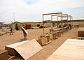 US Navy 050425-N-8102P-005 Seabees assigned to Naval Mobile Construction Battalion Two Four (NMCB-24), construct pre-fabricated Southwest Asia huts at Camp Korean Village, in western Iraq.jpg