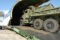 US Navy 050620-N-3879H-001 Seabees assigned to Naval Mobile Construction Battalion One (NMCB-1) load a heavy truck, along with 115 tons of equipment onto a Russian-built AN-124 Ruslan cargo aircraft.jpg