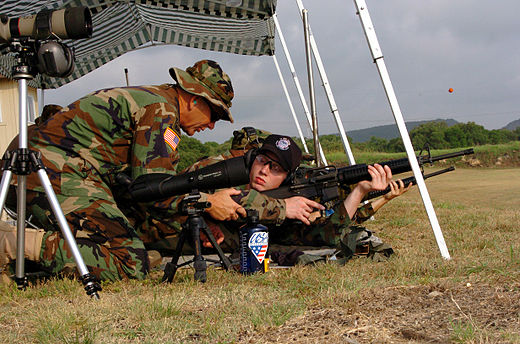U.S. Army Reserve Sgt. Maj., left, instructs U.S. Navy Midshipman on proper body positioning during live-fire marksmanship training in June 2005. US Navy 050627-A-2545J-007 U.S. Army Reserve Sgt. Maj. Robert Payne, left, instructs U.S. Navy Midshipman Jake Rankinen on proper body positioning during live fire marksmanship training.jpg