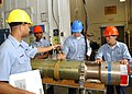 US Navy 050805-N-6936D-001 Sailors assigned to the Advanced Under Sea Weapons Department on board Naval Air Station Jacksonville, secure an inert Mark 46 torpedo to its cradle during a torpedo hoist training evolution.jpg
