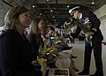US Navy 060224-N-6060O-166 Capt. Lawrence D. Burt's Family members receive flowers during the change of command ceremony for Carrier Air Wing Two (CVW-2) on board Naval Air Station Lemoore.jpg