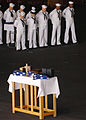 US Navy 060426-N-5758H-044 Sailors bow their heads in prayer during a burial at sea ceremony.jpg