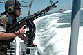 US Navy 060510-N-5330L-794 Master-at-Arms 3rd Class Matthew Kaczynski, assigned to Inshore Boat Unit Four Two (IBU-42), mans his M-60 machine gun.jpg