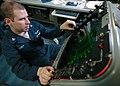 US Navy 060831-N-6236O-013 Aerographer's Mate 3rd Class Noah Levey tracks tropical storm.jpg