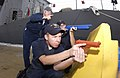 US Navy 061018-N-5060B-041 Fire Controlman 1st Class instructs Sonar Technician 3rd Class Garrett Teague and Boatswain's Mate Seaman Ryan Pursser during force protection training.jpg