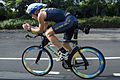 US Navy 061020-N-4856G-018 Special Operations Chief (SEAL) Mitch Hall assigned to Naval Special Warfare Center road tests the Navy SEAL racing bike in Kona, Hawaii one day prior to the Ironman Triathlon.jpg