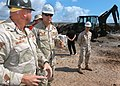 US Navy 061209-N-1328C-397 Commander, U.S. Naval Facilities Engineering Command Rear Adm. Richard E. Cellon speaks with Construction Electrician 1st Class Damien Brandlen, leading petty officer for the Tadjoura Primary school p.jpg