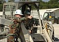 US Navy 070125-N-0775Y-063 Chief Utilitiesman James Sherry instructs Equipment Operator Constructionman Albert Amozarrutia in the direction to continue cleaning during a runway repair exercise at Kadena Air Base, Okinawa.jpg