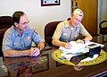 US Navy 070510-N-6357K-001 Naval Base Point Loma Commanding Officer, Capt. Mark D. Patton, signs a Joint Wildland Fire Management Plan along with Terry Dimattio, superintendent of Cabrillo National Park.jpg