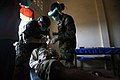 US Navy 071129-M-3378S-110 Lt. Cmdr. Ann Monasky, a dentist from Combat Logistics Battalion, 31st Marine Expeditionary Unit, and Hospital Corpsman 3rd Class Dominique Banks, a CLB-31 dental technician, conduct a tooth extractio.jpg