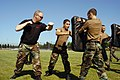US Navy 080716-N-4386D-001 Master-at-Arms 1st Class Doug Terou, left, assigned to Naval Station Everett, Wash., encourages members of the U.S. Naval Sea Cadet Corps to work during a master-at-arms training exercise.jpg